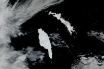Satellite images from December 14 show the Antarctic iceberg A-68A (left) closing in on the island ...
