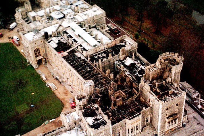 An aerial view of Windsor Castle in the United Kingdom shows damage to the roof caused ...
