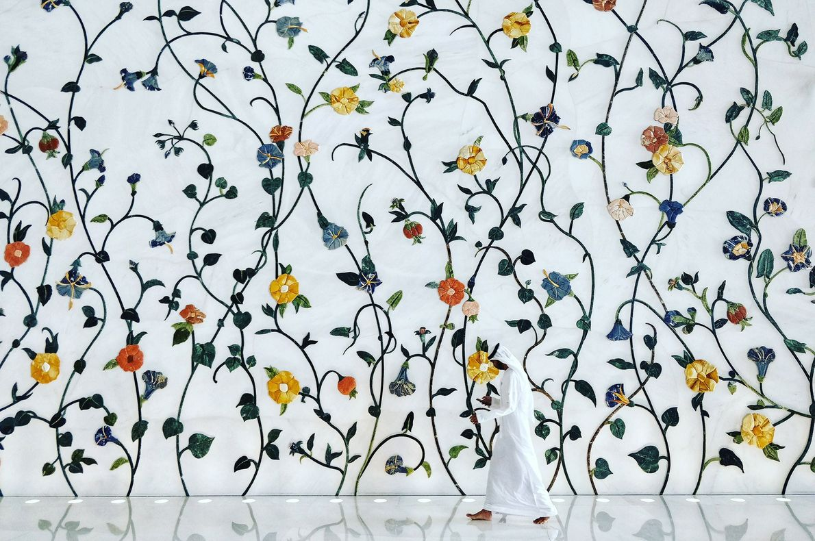 Vibrant floral patterns, designed by British artist and illustrator Kevin Dean, blanket the walls and floors ...