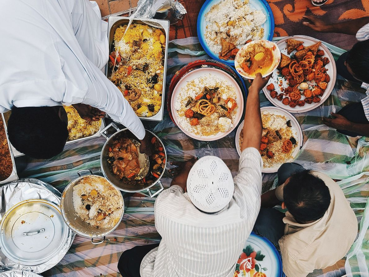 People gather before iftar, the evening meal during the Islamic holy month of Ramadan, when Muslims ...
