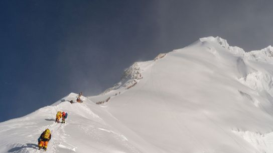 Climbers wait in the queue to summit Mount Everest in May 2019. The stream of people ...
