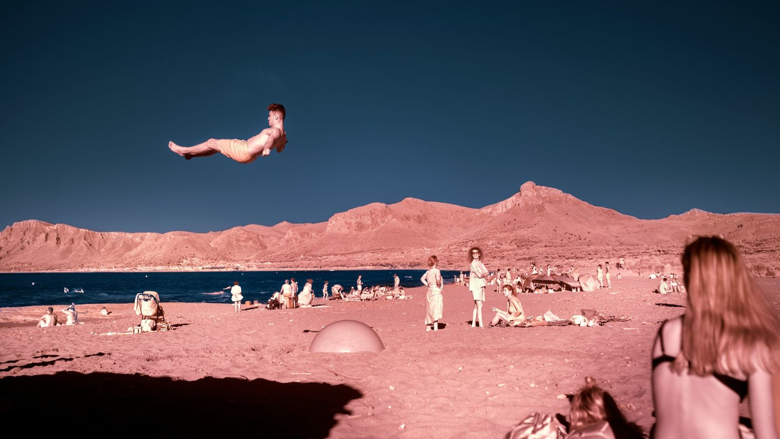 At Son Serra de Marina, locals enjoy a quiet day at the beach just before Mallorca ...