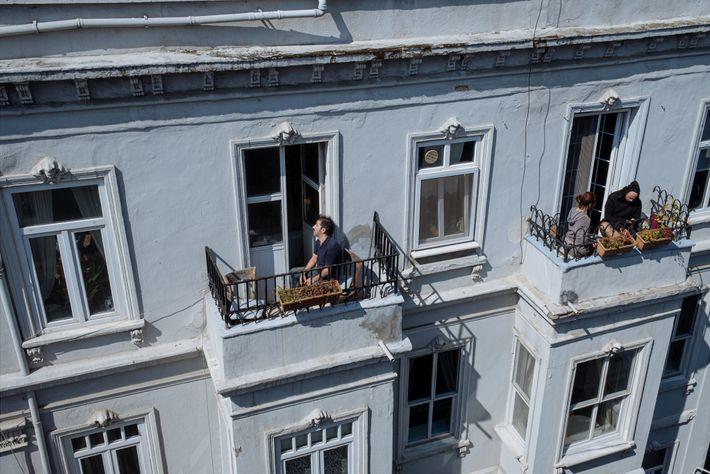 In Istanbul's Beyoglu neighborhood, residents sun themselves on their balconies.