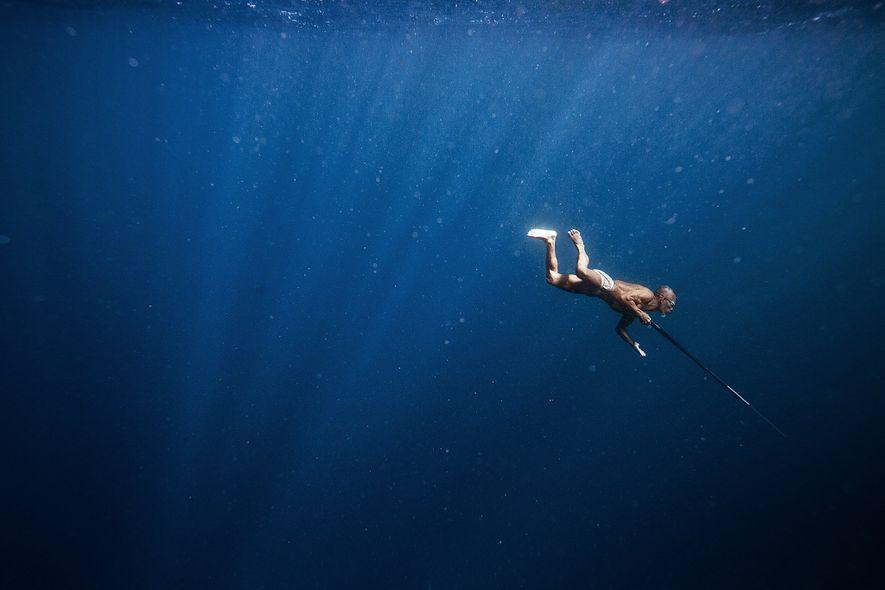 An elder of the Banjo tribe hunts for fish off the coast of Sampela, Indonesia.