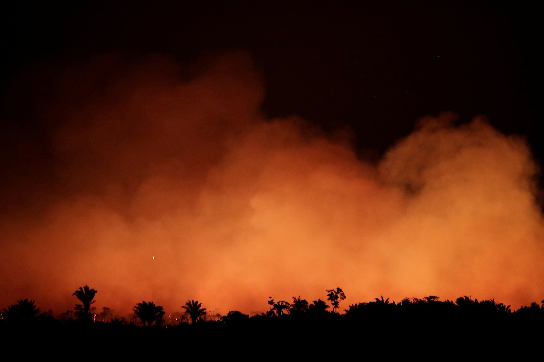 Smoke billows during a fire in an area of the Amazon rainforest near Humaita, Amazonas State, Brazil, on August 17.