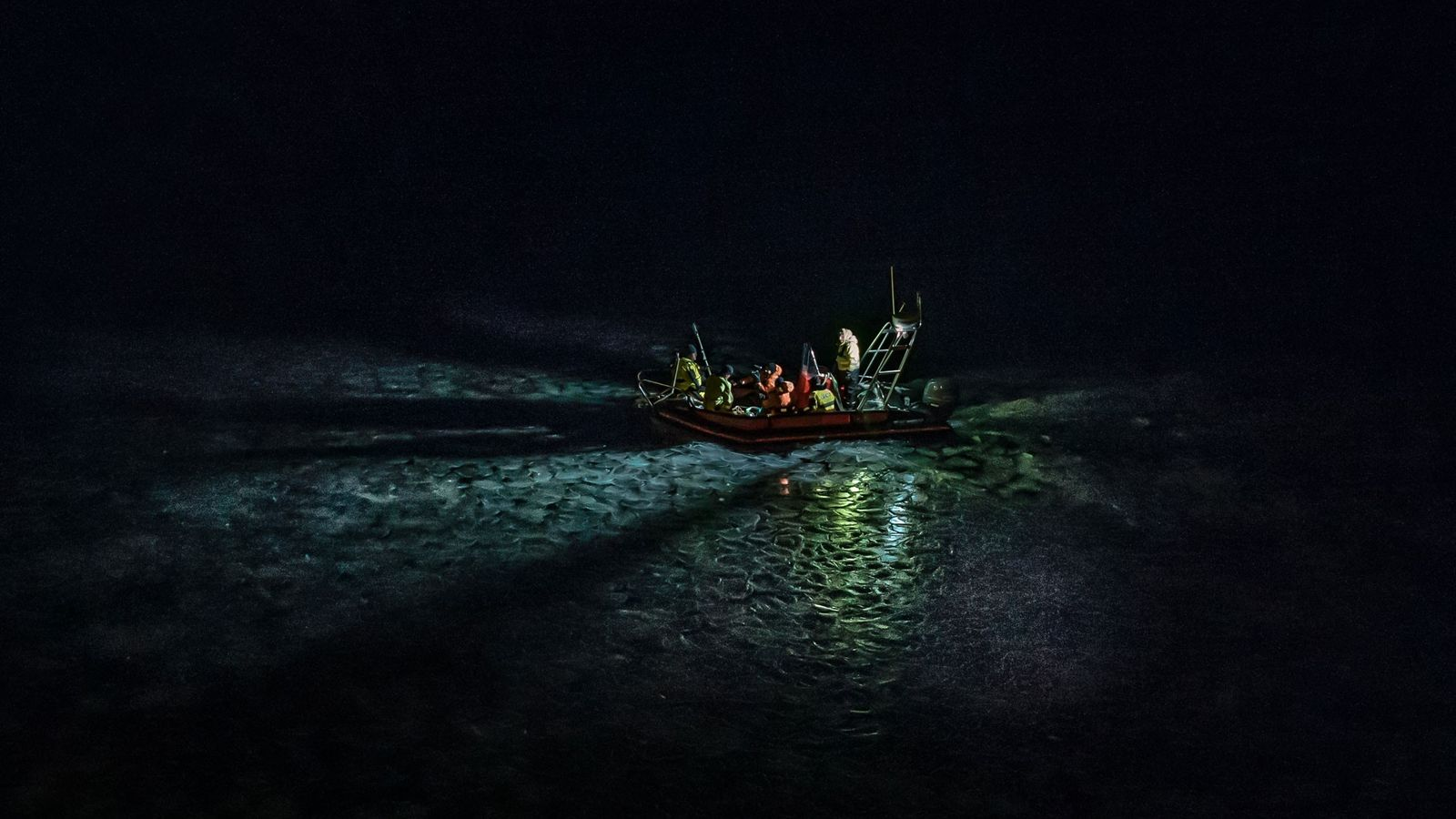 A research vessel pilots a team of Arctic research scientists through ice north of Svalbard, Norway. ...