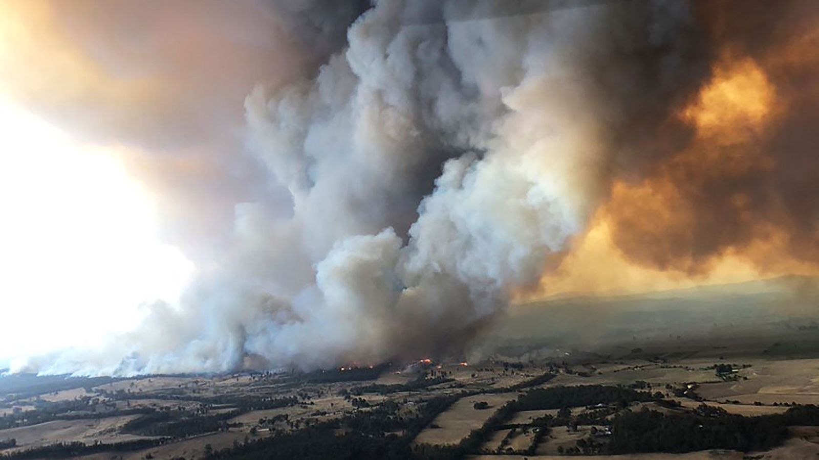 On December 30, 2019, wildfires raged under plumes of smoke in Bairnsdale, Australia. Thousands of tourists ...