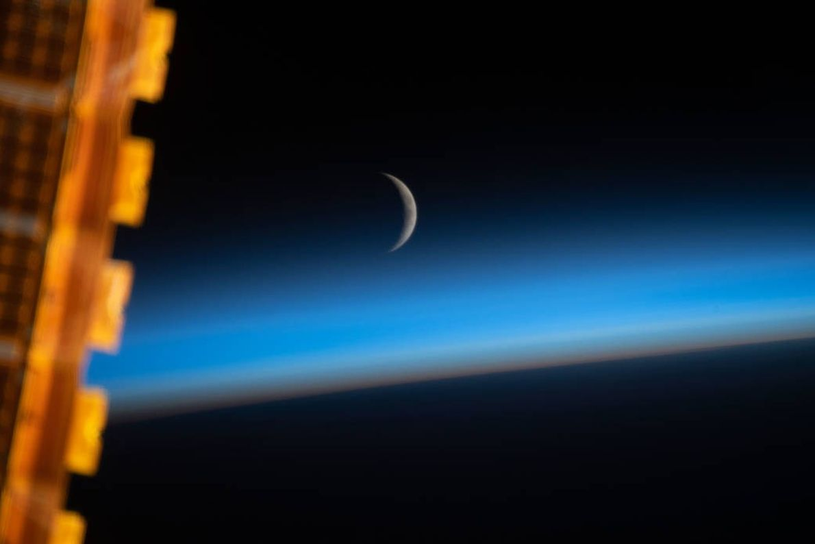 On May 8, the crew of the International Space Station photographed the waxing crescent moon at ...