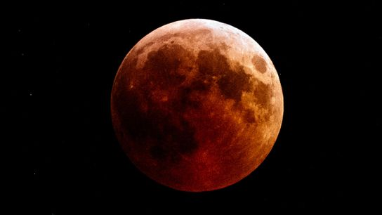 A so-called blood moon hangs over the town of Kazanlak in Bulgaria during the July 27, ...