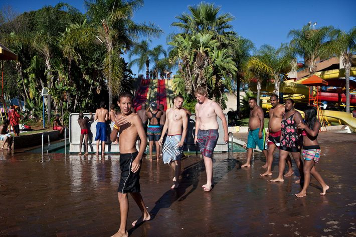 A group of young people gather at the Bela Bela Resort swimming pool. Bela-Bela, formerly known ...