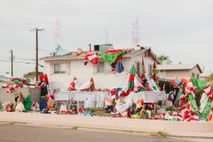 The Tempe, Arizona home of Steve Lanzillo was literally swarmed by inflatable Santas during Christmas season ...