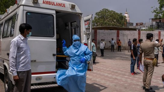 Medical workers arrive at a community kitchen to test people for COVID-19 in a virus hotspot ...