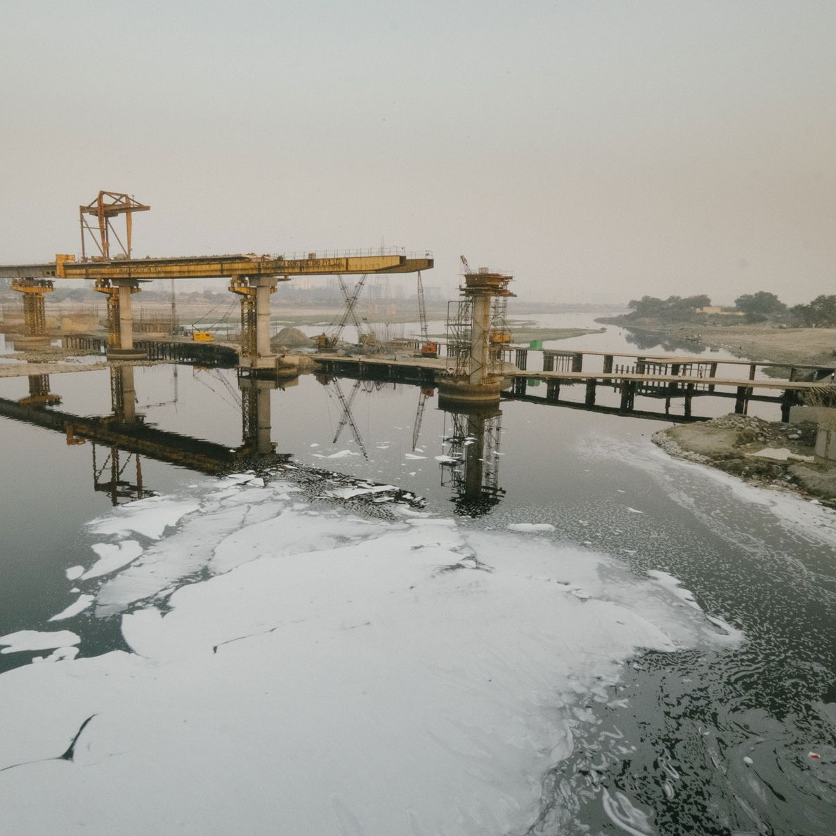Nearby industries dump their chemical waste into the Yamuna, which has left the river blanketed in ...