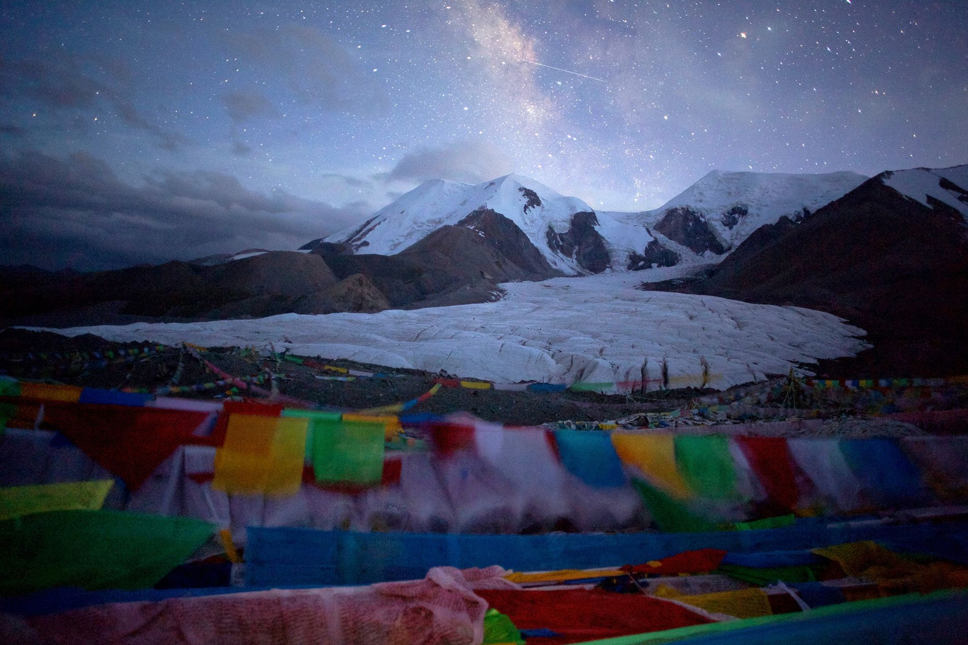 Stars sparkle over a glacier on Animaqin Mountain in Tibet's Guoluo County. The thin air and ...