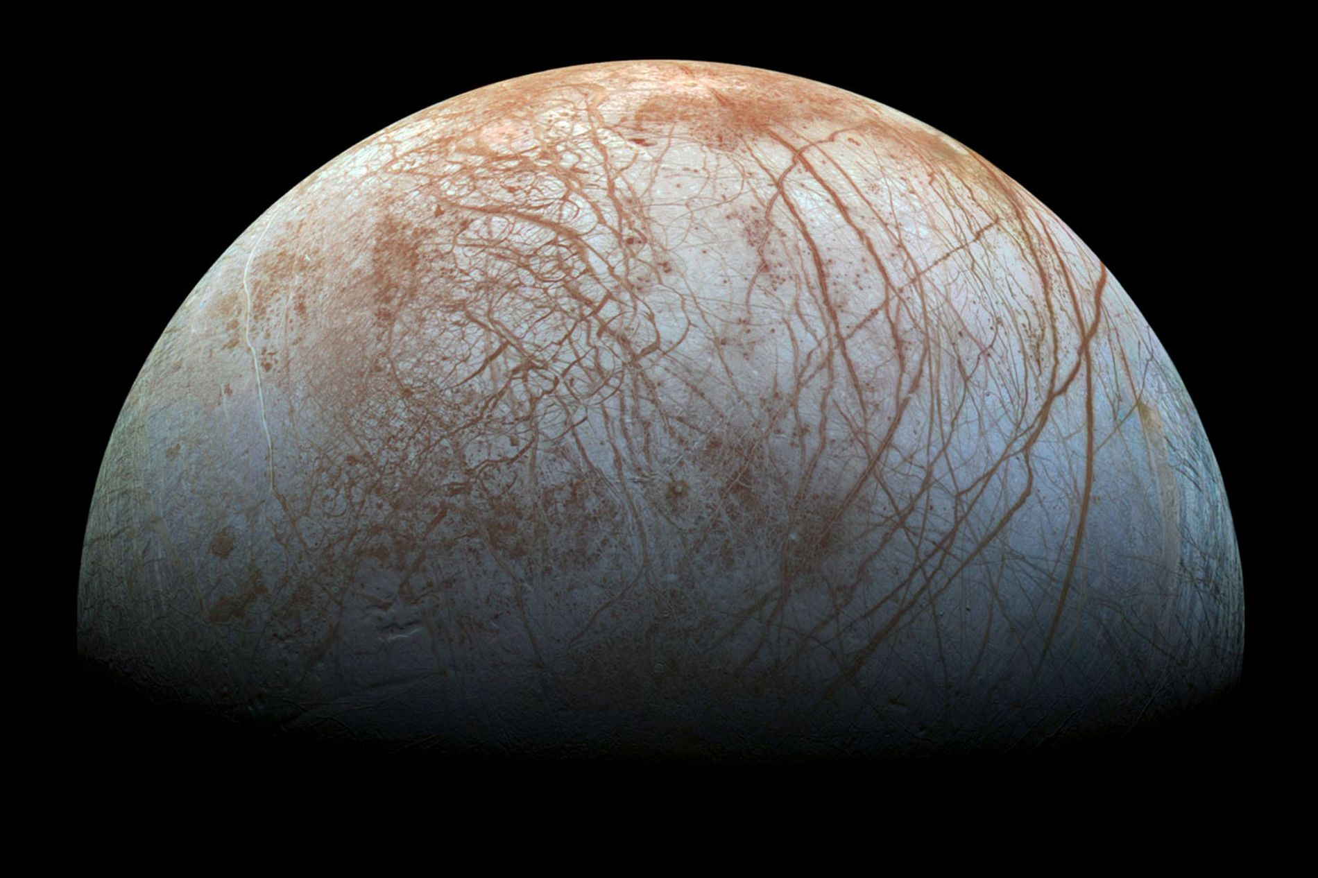 Jupiter's moon Europa is covered with a thick icy crust thought to cover a vast water ...