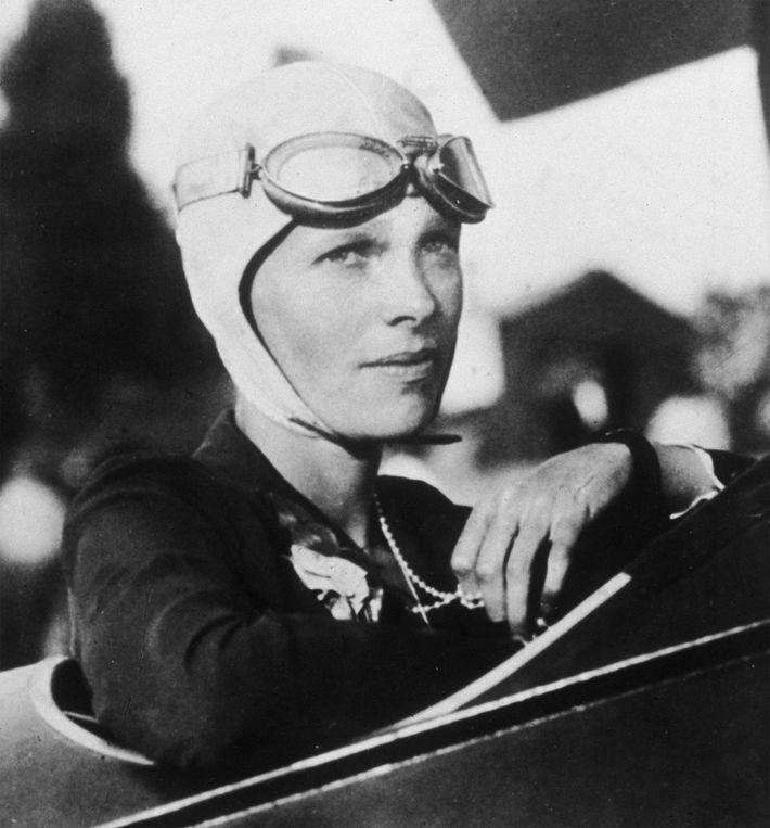 Headshot portrait of American aviator Amelia Earhart in the cockpit of her plane, circa 1925.