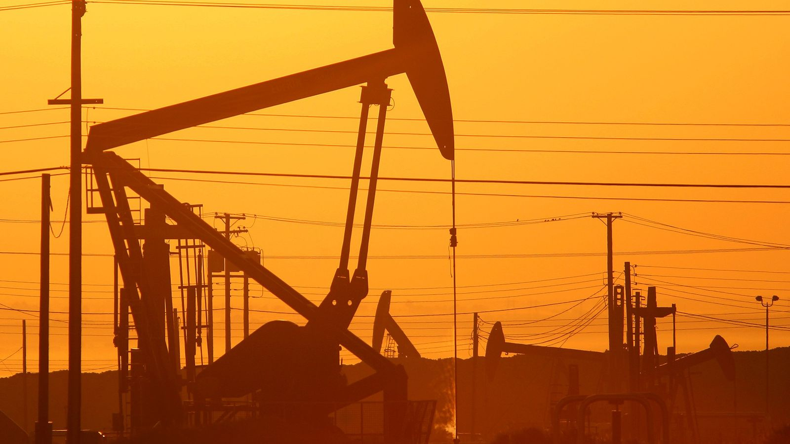 Pump jacks are seen at dawn in an oil field over the Monterey Shale formation in ...