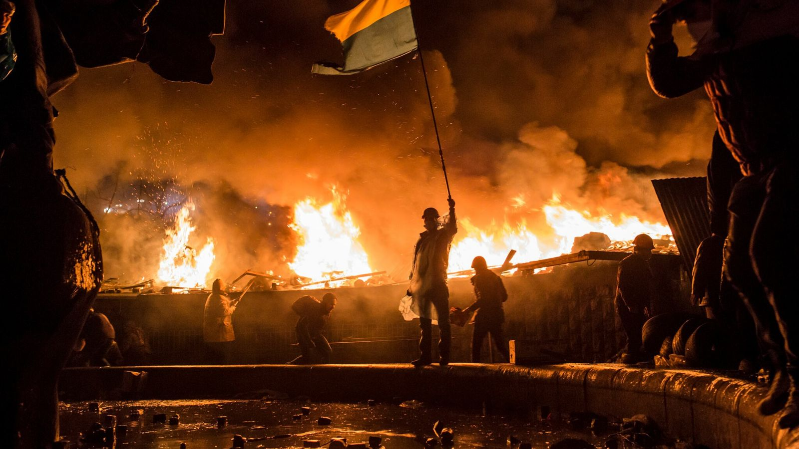 In Kyiv, Ukraine, anti-government protesters guard the perimeter of Independence Square, known as Maidan. In 2014, ...