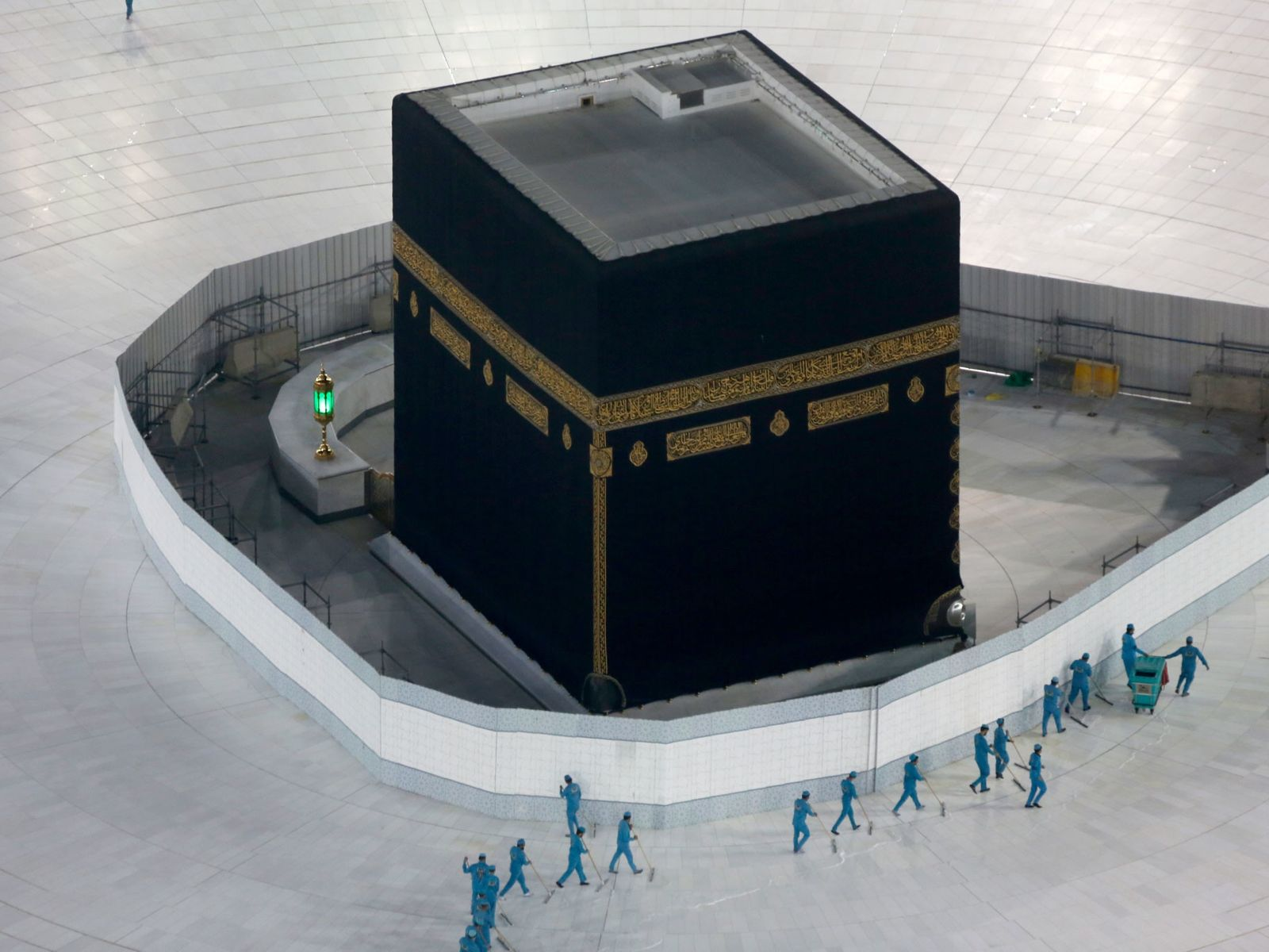 Workers disinfect the plaza around the Kaaba, the holiest site in Islam, at the Grand Mosque ...