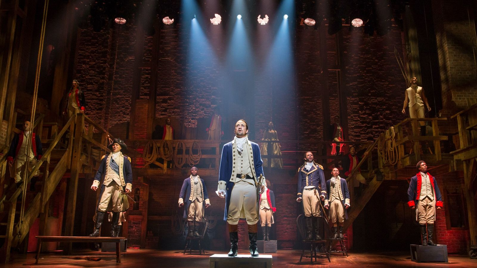 """Lin-Manuel Miranda, creator and star of """"Hamilton,"""" stands center with the original ensemble cast on Broadway ..."""