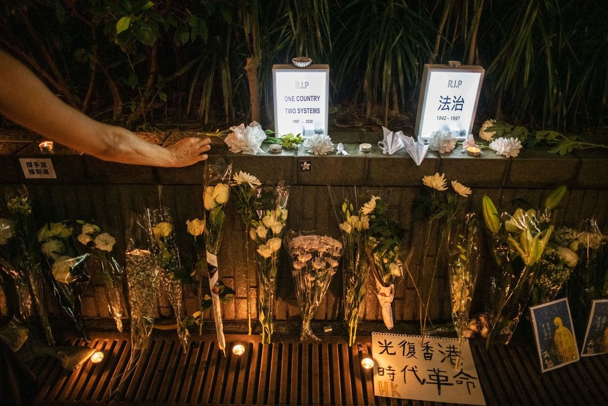 In July, a woman in Hong Kong pays her respects at a makeshift memorial for Marcus ...