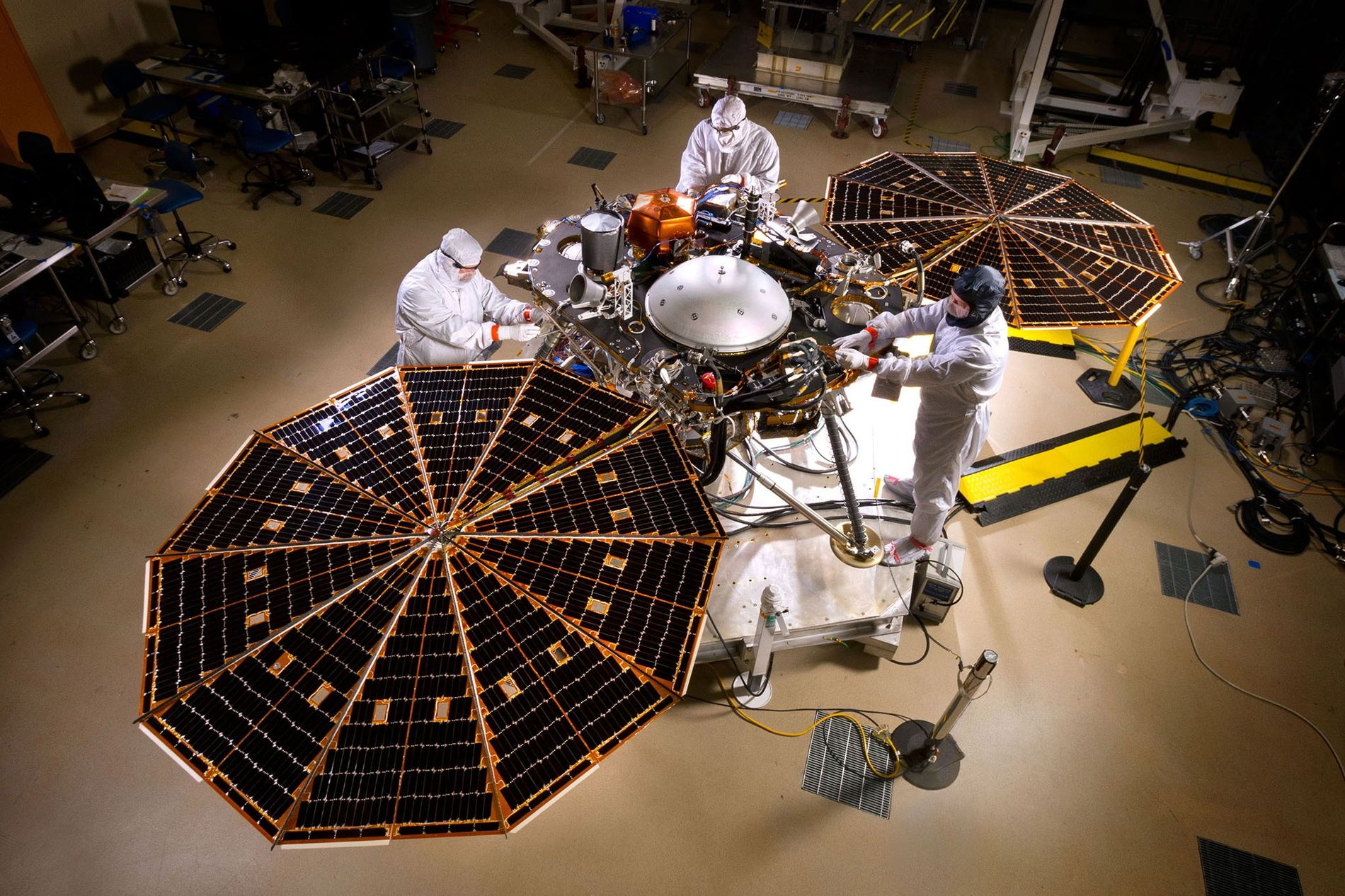 Engineers deploy the solar arrays on NASA's InSight lander inside a clean room at Lockheed Martin ...