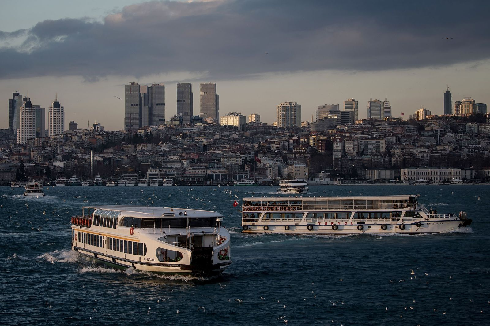 Ferries cross the Bosporus in Istanbul. To reduce crowding, the government plans to build a massive ...