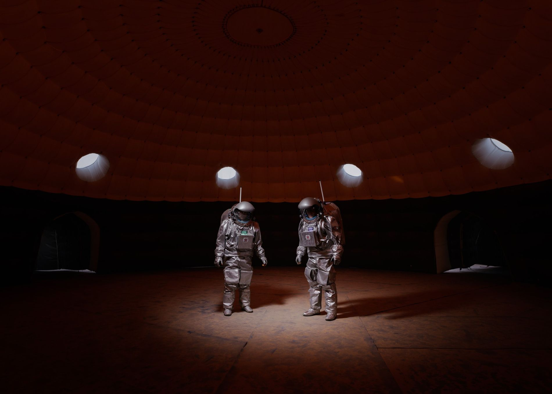 Crew members Gernot Grömer and João Lousada stand inside the habitat module of Kepler Station, the ...