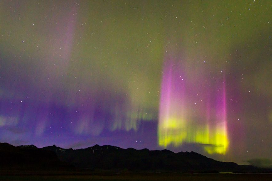Northern Lights display with strong light pillars appears during a geomagnetic solar storm on the south ...