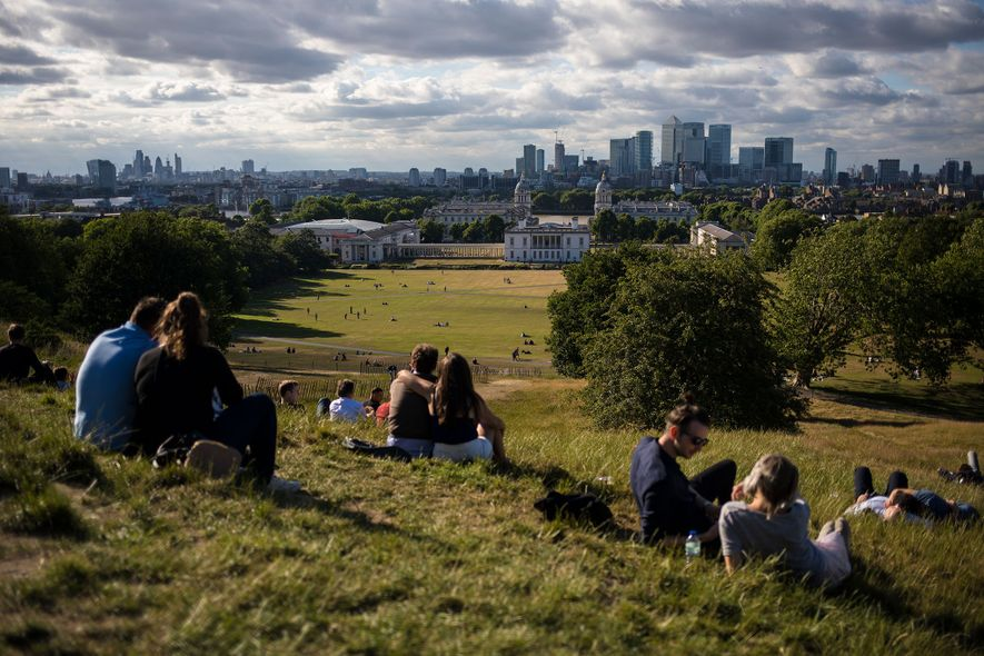 People spend the afternnoon at Greenwich Park and enjoy the London skyline. London is set to ...