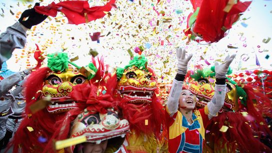 Chinese folk artists perform the lion dance at a temple fair to celebrate the Lunar New ...
