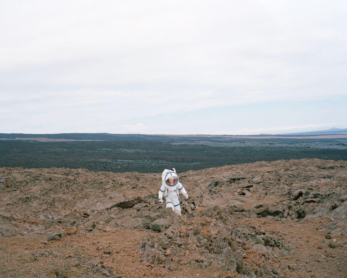 "Commander Martha Lenio of the HI-SEAS III mission in Hawaii tests the ""Martian"" terrain in her ..."