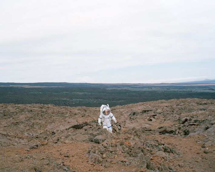 "Commander Martha Lenio of the HI-SEAS III mission in Hawaii tests the ""Martian"" terrain in her ..."
