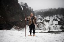 Ito Ryoichi wears the traditional vest and shoes of the Matagi hunters. Today, the hunters only ...