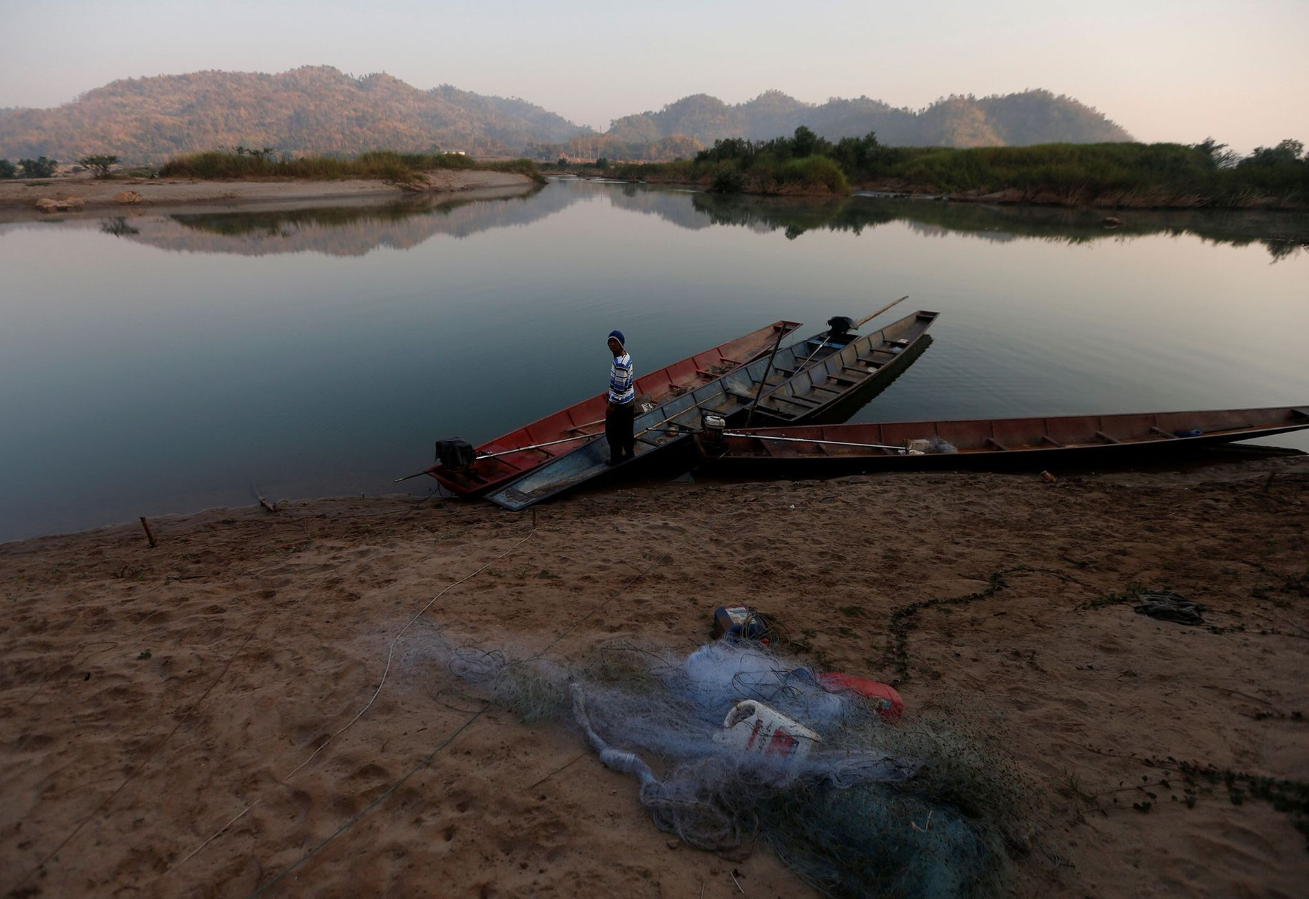 A fisherman on the banks of the Mekong River outside Nong Khai, Thailand, on January 10.