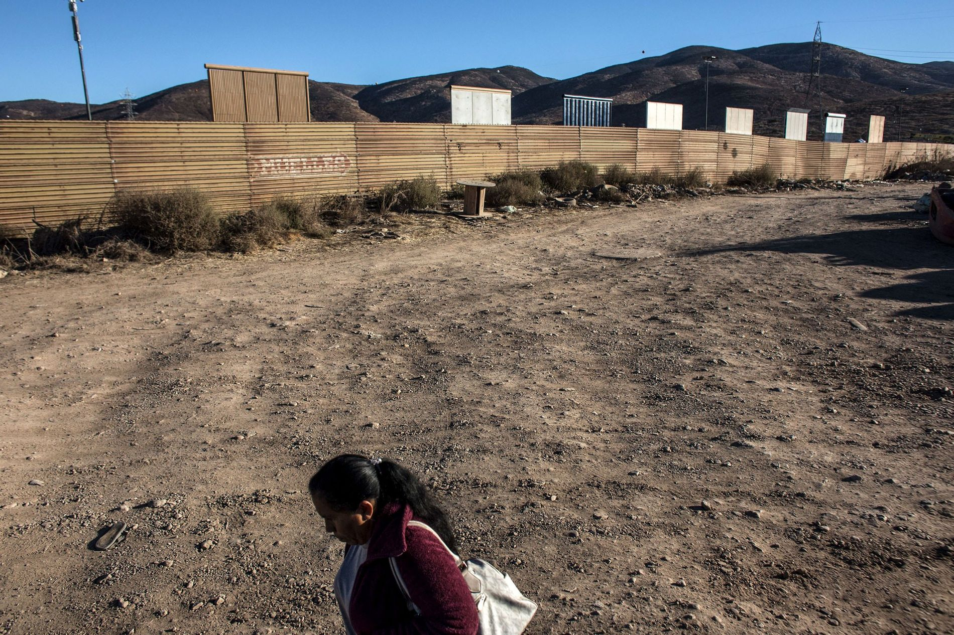Above is the eighth prototype of President Donald Trump's U.S.-Mexico border wall, under construction near San ...