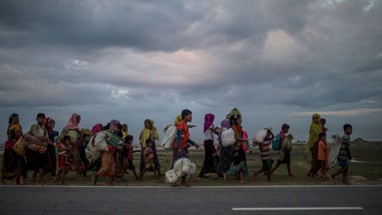 Rohingyan refugees, forced to migrate to Bangladesh from Myanmar, walk in search of refugee camps.