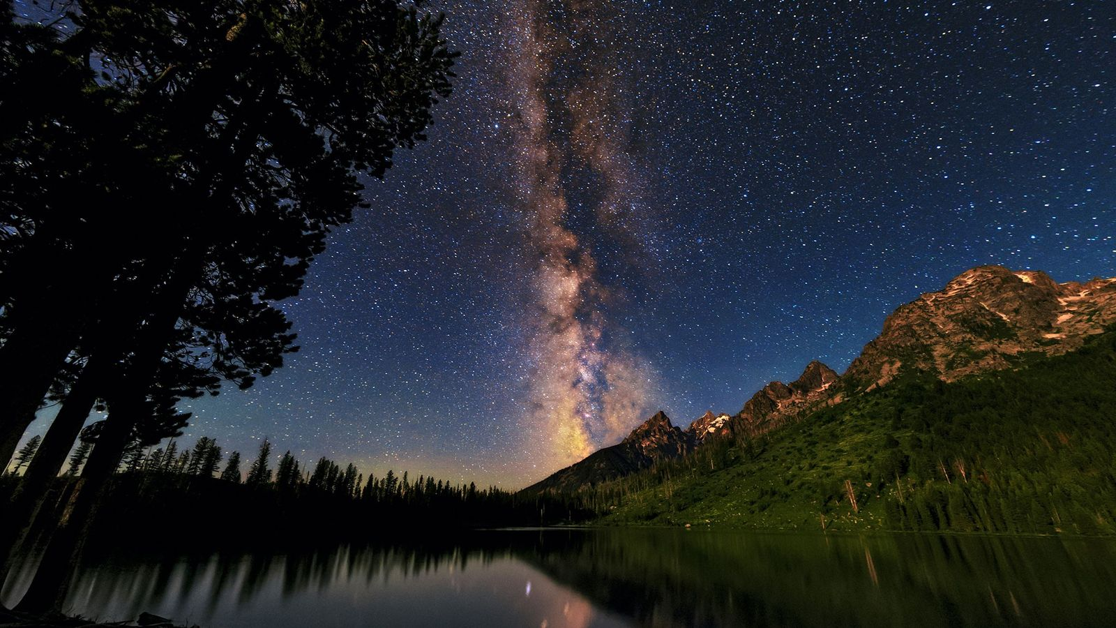 The bright band of the Milky Way stretches across the Wyoming sky in Grand Teton National ...