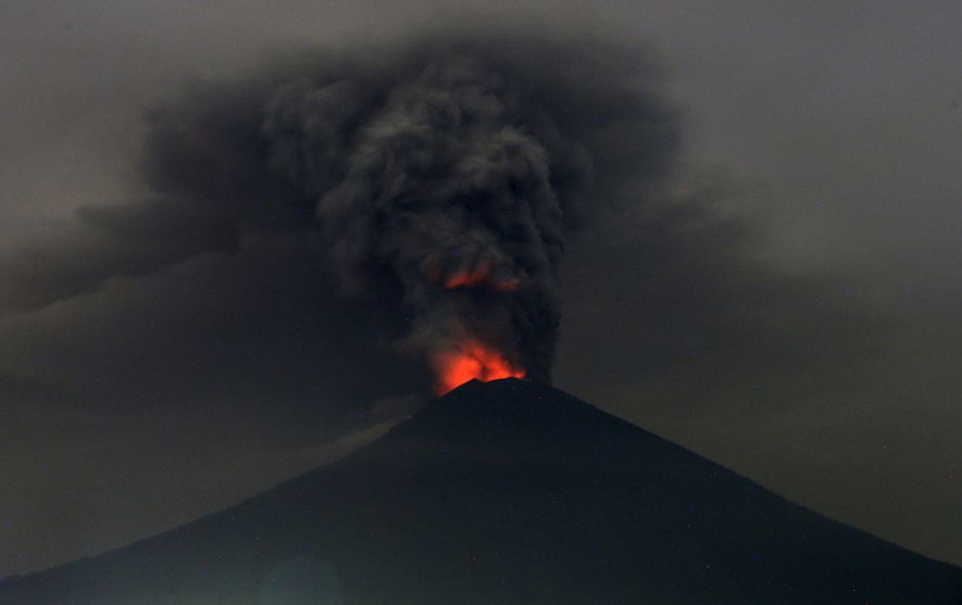 A view of Mount Agung erupting in Bali, Indonesia on Monday. Indonesia authorities have raised the ...