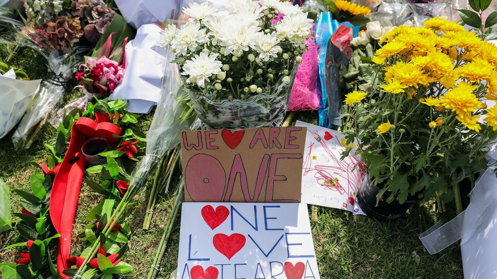 Flowers and words from mourners represent an outpouring of love and unity at Masjid Umar mosque ...