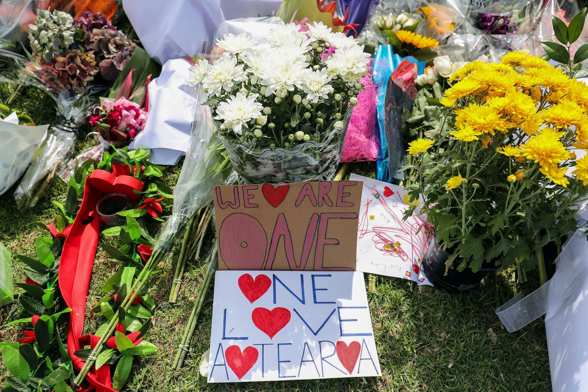 <p>Flowers and words from mourners represent an outpouring of love and unity at Masjid Umar mosque in Christchurch, New Zealand. Fifty people died in the mass shootings on March 15, and 50 more were injured.</p>
