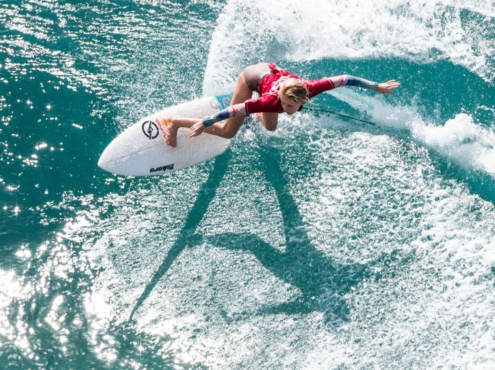 Your Shot photographer Tracy Desiderio photographed a surfer catching a wave in Honolua Bay, Hawaii just ...