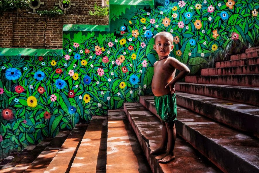 Your Shot photographer Ritesh Ghosh documented this young boy standing on a set of colourful stairs ...