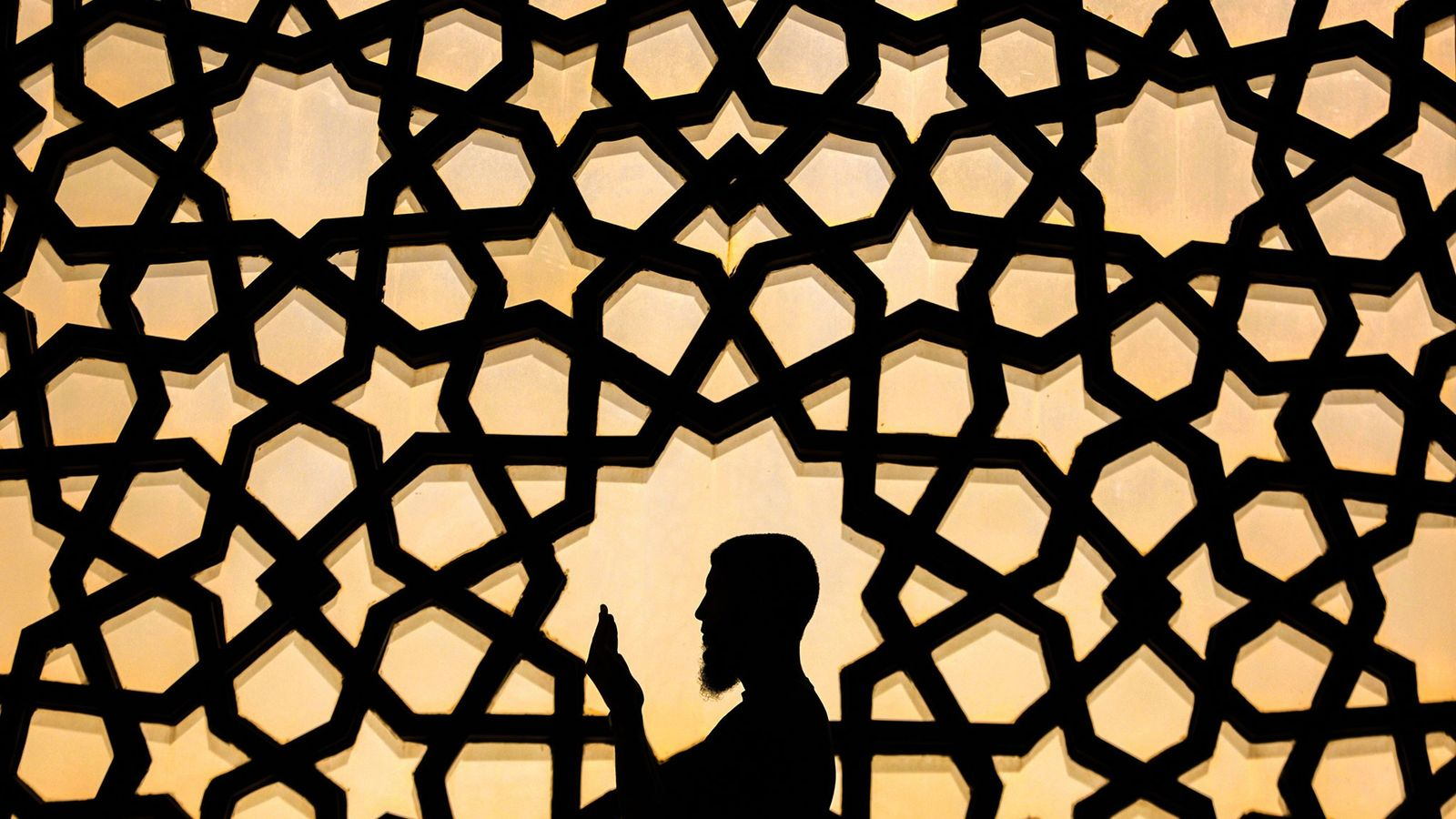 A Palestinian man prays at the Great Mosque of Gaza during the holy month of Ramadan ...