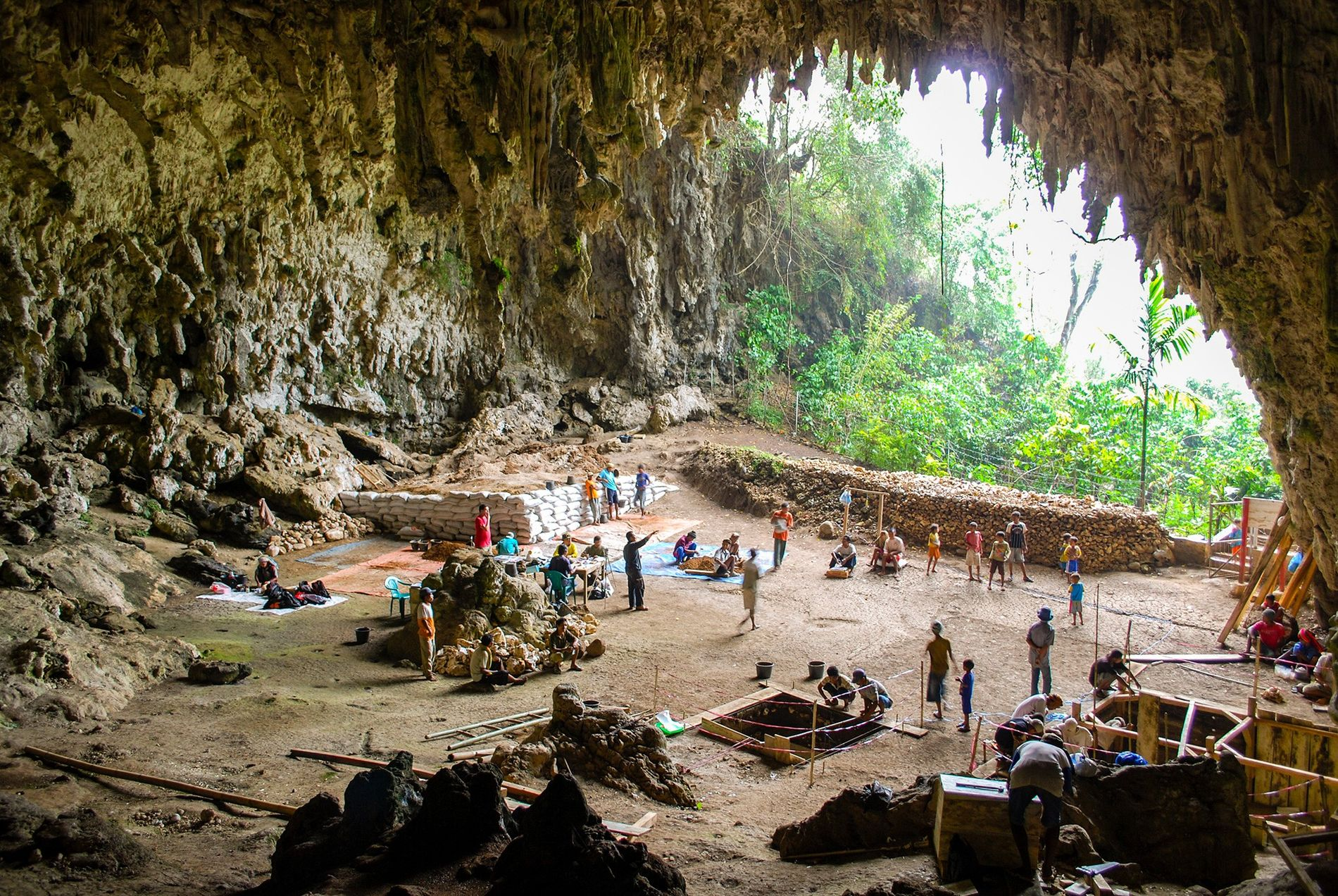 Archaeologists excavate in Liang Bua, a limestone cave on the Indonesian island of Flores where the ...