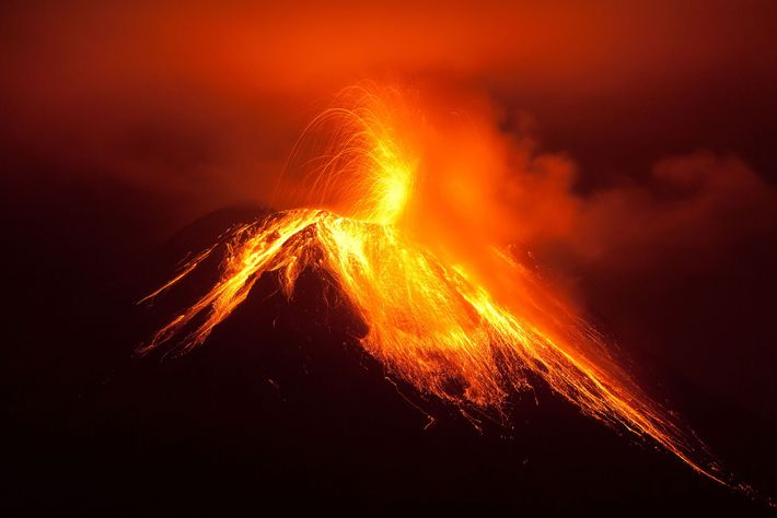 The Tungurahua volcano erupts in the night. Tungurahua, also called the Black Giant, is one of ...