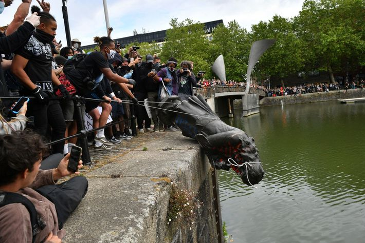 Demonstrators throw the statue of Edward Colston, an infamous 17th century slave trader, into Bristol harbour ...
