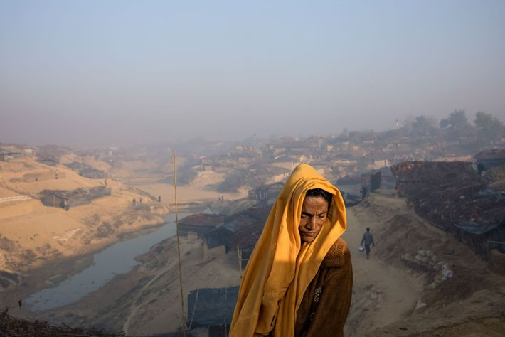 A Rohingya woman, a member of the Muslim minority in Myanmar, stands on a plateau near ...