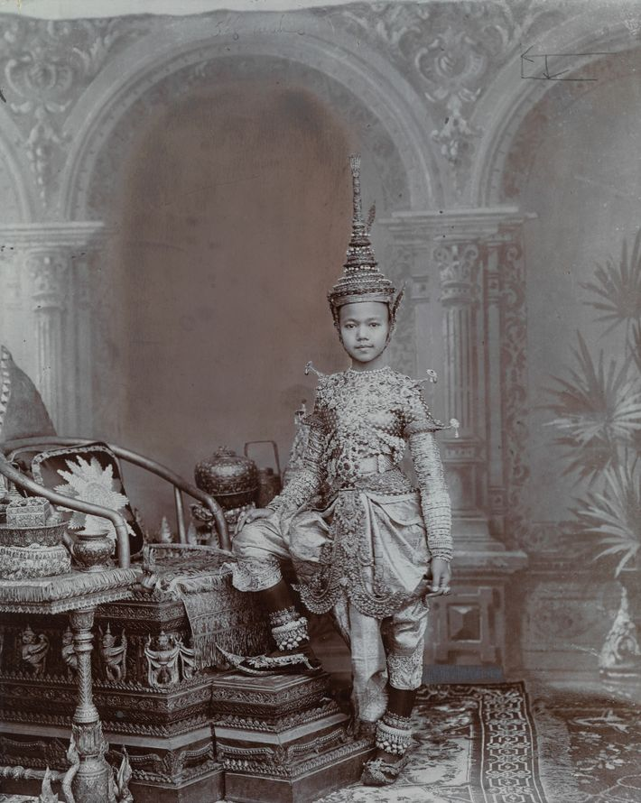 A Siamese prince wears a full regalia of jewels, including a headpiece modeled after a chadok, ...