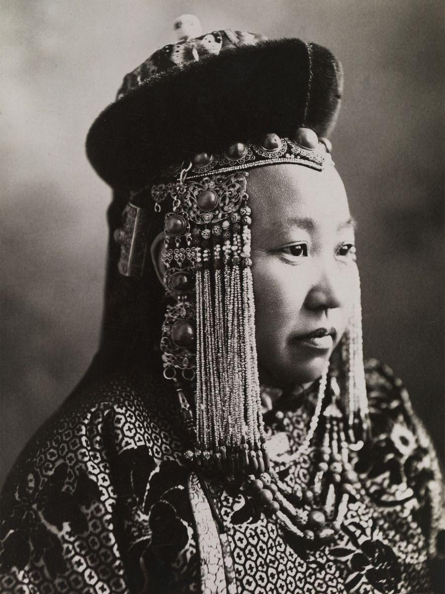 A Mongolian princess wears full court dress, including a traditional headdress.